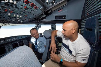 BOSTON, MA - JANUARY 30: Manager Alex Cora of the Boston Red Sox talks with the pilots in the cockpit on the plane en route during a Boston Red Sox hurricane relief trip from Boston, Massachusetts to Caguas, Puerto Rico on January 30, 2018 . (Photo by Billie Weiss/Boston Red Sox/Getty Images) *** Local Caption *** Alex Cora