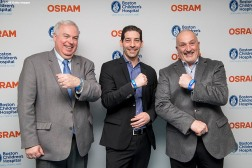 BOSTON, MA - JANUARY 29: Grant Wright, Chief Executive Officer of OSRAM, Michael Flieger, Chief Financial Officer of OSRAM, and Dick Argys, Chief Administrative Officer of Boston Children's Hospital, pose for a photograph during the Light Up Our Hospital campaign kick-off with OSRAM at Boston Children's Hospital on January 29, 2018 in Boston, Massachusetts. (Photo by Billie Weiss/Getty Images for Boston Children's Hospital)