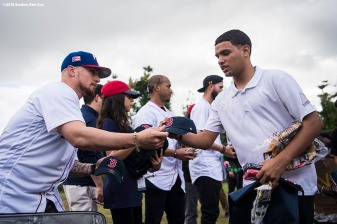 SAN JUAN, PUERTO RICO - JANUARY 30: Christian Vazquez #7 of the Boston Red Sox distributes baseball equipment during a Boston Red Sox hurricane relief trip from Boston, Massachusetts to Caguas, Puerto Rico on January 30, 2018 . (Photo by Billie Weiss/Boston Red Sox/Getty Images) *** Local Caption *** Christian Vazquez