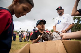 SAN JUAN, PUERTO RICO - JANUARY 30: A young fan receives a new baseball glove from during a Boston Red Sox hurricane relief trip from Boston, Massachusetts to Caguas, Puerto Rico on January 30, 2018 . (Photo by Billie Weiss/Boston Red Sox/Getty Images) *** Local Caption ***