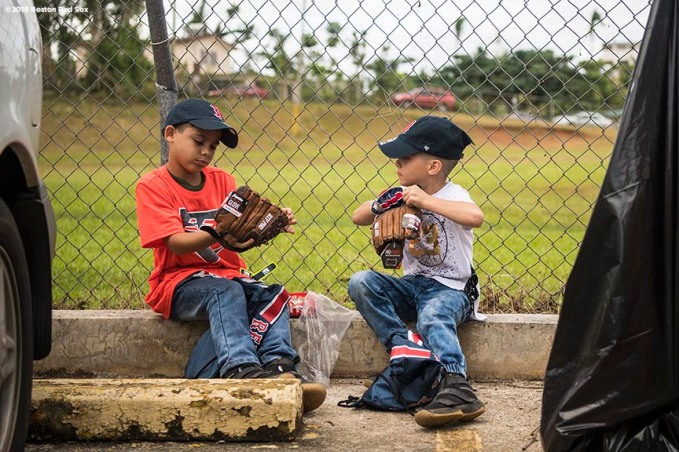 SAN JUAN, PUERTO RICO - JANUARY 30: Young fans inspect their new baseball gloves during a Boston Red Sox hurricane relief trip from Boston, Massachusetts to Caguas, Puerto Rico on January 30, 2018 . (Photo by Billie Weiss/Boston Red Sox/Getty Images) *** Local Caption ***