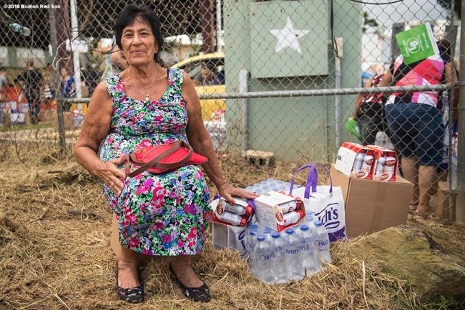 SAN JUAN, PUERTO RICO - JANUARY 30: A resident looks on after receiving food supplies during a Boston Red Sox hurricane relief trip from Boston, Massachusetts to Caguas, Puerto Rico on January 30, 2018 . (Photo by Billie Weiss/Boston Red Sox/Getty Images) *** Local Caption ***