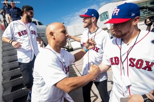 SAN JUAN, PUERTO RICO - JANUARY 30: Manager Alex Cora of the Boston Red Sox greets Rick Porcello #22, Chris Sale #41, and Christian Vazquez #7 as he exits the plane during a Boston Red Sox hurricane relief trip from Boston, Massachusetts to Caguas, Puerto Rico on January 30, 2018 . (Photo by Billie Weiss/Boston Red Sox/Getty Images) *** Local Caption *** Alex Cora; Rick Porcello; Chris Sale; Christian Vazquez