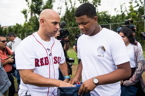 SAN JUAN, PUERTO RICO - JANUARY 30: Manager Alex Cora of the Boston Red Sox distributes baseball equipment during a Boston Red Sox hurricane relief trip from Boston, Massachusetts to Caguas, Puerto Rico on January 30, 2018 . (Photo by Billie Weiss/Boston Red Sox/Getty Images) *** Local Caption *** Alex Cora