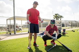FT. MYERS, FL - FEBRUARY 12: Andrew Benintendi #16 and Brock Holt #12 of the Boston Red Sox react during a team workout on February 12, 2018 at Fenway South in Fort Myers, Florida . (Photo by Billie Weiss/Boston Red Sox/Getty Images) *** Local Caption *** Andrew Benintendi; Brock Holt