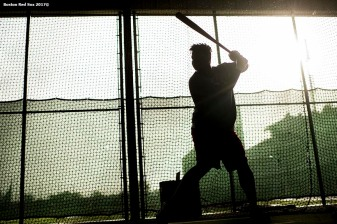 FT. MYERS, FL - FEBRUARY 13: Rafael Devers #11 of the Boston Red Sox takes batting practice in the cage during a team workout on February 13, 2018 at Fenway South in Fort Myers, Florida . (Photo by Billie Weiss/Boston Red Sox/Getty Images) *** Local Caption *** Rafael Devers