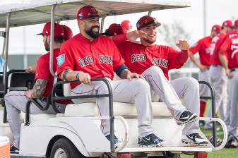 FT. MYERS, FL - FEBRUARY 14: Sandy Leon #3 and Christian Vazquez #7 of the Boston Red Sox react as they ride on a golf cart during a team workout on February 14, 2018 at Fenway South in Fort Myers, Florida . (Photo by Billie Weiss/Boston Red Sox/Getty Images) *** Local Caption *** Sandy Leon; Christian Vazquez