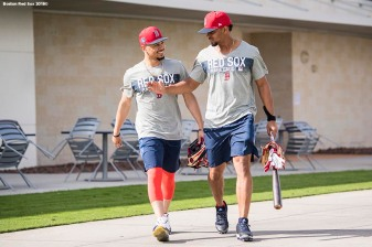 FT. MYERS, FL - FEBRUARY 14: Mookie Betts #50 of the Boston Red Sox reacts with Xander Bogaerts #2 as they exit the clubhouse during a team workout on February 14, 2018 at Fenway South in Fort Myers, Florida . (Photo by Billie Weiss/Boston Red Sox/Getty Images) *** Local Caption *** Mookie Betts; Xander Bogaerts
