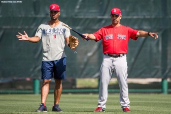 FT. MYERS, FL - FEBRUARY 15: Manager Alex Cora reacts with Xander Bogaerts #2 of the Boston Red Sox during a team workout on February 15, 2018 at Fenway South in Fort Myers, Florida . (Photo by Billie Weiss/Boston Red Sox/Getty Images) *** Local Caption *** Xander Bogaerts; Alex Cora