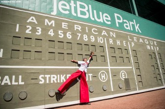 FT. MYERS, FL - FEBRUARY 16: An entertainer poses in front of the Green Monster scoreboard during a Boston Red Sox open house on February 17, 2018 at jetBlue Park at Fenway South in Fort Myers, Florida . (Photo by Billie Weiss/Boston Red Sox/Getty Images) *** Local Caption ***