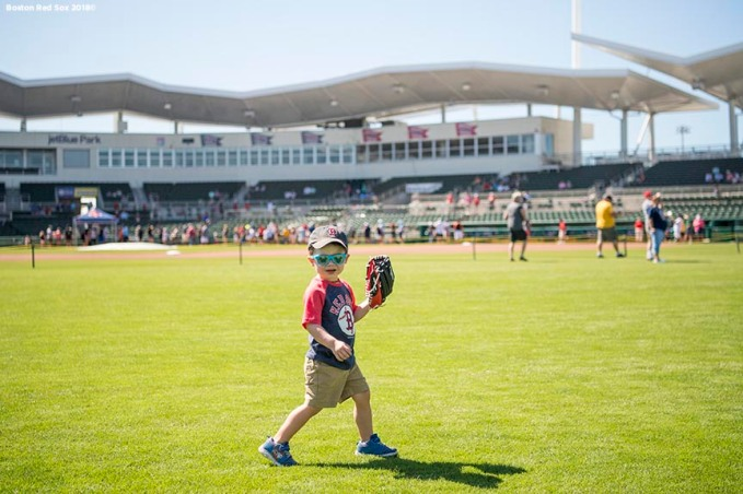 FT. MYERS, FL - FEBRUARY 16: A young fan plays in the outfield during a Boston Red Sox open house on February 17, 2018 at jetBlue Park at Fenway South in Fort Myers, Florida . (Photo by Billie Weiss/Boston Red Sox/Getty Images) *** Local Caption ***