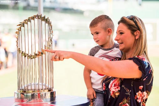 FT. MYERS, FL - FEBRUARY 16: Fans pose with the 2004 World Series trophy during a Boston Red Sox open house on February 17, 2018 at jetBlue Park at Fenway South in Fort Myers, Florida . (Photo by Billie Weiss/Boston Red Sox/Getty Images) *** Local Caption ***