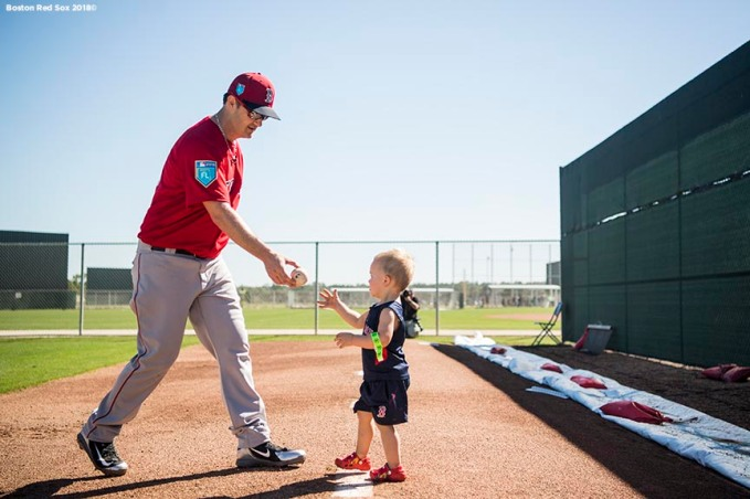 FT. MYERS, FL - FEBRUARY 16: Steven Wright #35 of the Boston Red Sox plays with his son Lucas during a team workout on February 17, 2018 at jetBlue Park at Fenway South in Fort Myers, Florida . (Photo by Billie Weiss/Boston Red Sox/Getty Images) *** Local Caption *** Steven Wright