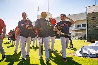 FT. MYERS, FL - FEBRUARY 19: Mitch Moreland #18, Eduardo Nunez #10, and Andrew Benintendi #16 of the Boston Red Sox walk toward the field during a team workout on February 19, 2018 at jetBlue Park at Fenway South in Fort Myers, Florida . (Photo by Billie Weiss/Boston Red Sox/Getty Images) *** Local Caption *** Mitch Moreland; Eduardo Nunez; Andrew Benintendi