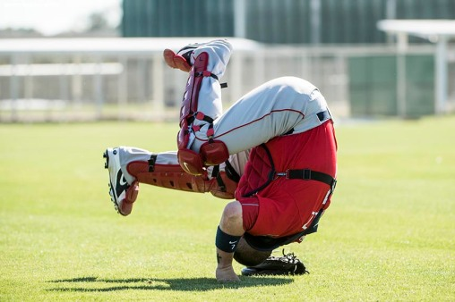 FT. MYERS, FL - FEBRUARY 19: Christian Vazquez #7 of the Boston Red Sox does a somersault during a team workout on February 19, 2018 at jetBlue Park at Fenway South in Fort Myers, Florida . (Photo by Billie Weiss/Boston Red Sox/Getty Images) *** Local Caption *** Christian Vazquez