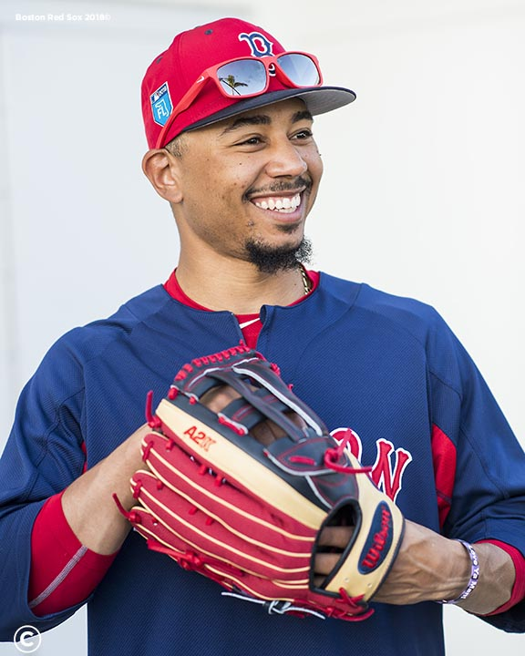 FT. MYERS, FL - FEBRUARY 21: Mookie Betts #50 of the Boston Red Sox reacts as he holds a Wilson glove during a team workout on February 21, 2018 at jetBlue Park at Fenway South in Fort Myers, Florida . (Photo by Billie Weiss/Boston Red Sox/Getty Images) *** Local Caption *** Mookie Betts