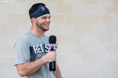 FT. MYERS, FL - FEBRUARY 21: Andrew Benintendi #16 of the Boston Red Sox is interviewed by MLB Network during a team workout on February 21, 2018 at jetBlue Park at Fenway South in Fort Myers, Florida . (Photo by Billie Weiss/Boston Red Sox/Getty Images) *** Local Caption *** Andrew Benintendi