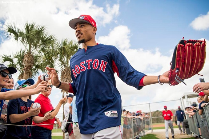 FT. MYERS, FL - FEBRUARY 21: Mookie Betts #50 of the Boston Red Sox high fives fans during a team workout on February 21, 2018 at jetBlue Park at Fenway South in Fort Myers, Florida . (Photo by Billie Weiss/Boston Red Sox/Getty Images) *** Local Caption *** Mookie Betts