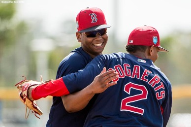 FT. MYERS, FL - FEBRUARY 21: Rafael Devers #11 reacts with Xander Bogaerts #2 of the Boston Red Sox during a team workout on February 21, 2018 at jetBlue Park at Fenway South in Fort Myers, Florida . (Photo by Billie Weiss/Boston Red Sox/Getty Images) *** Local Caption *** Rafael Devers; Xander Bogaerts