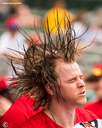 FT. MYERS, FL - FEBRUARY 22: Brock Holt #12 of the Boston Red Sox flips water through his hair during a game against Northeastern University on February 22, 2018 at jetBlue Park at Fenway South in Fort Myers, Florida . (Photo by Billie Weiss/Boston Red Sox/Getty Images) *** Local Caption *** Brock Holt