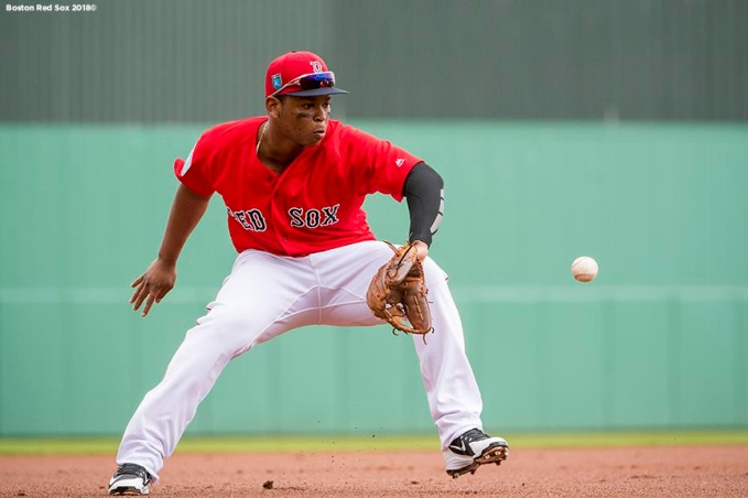 FT. MYERS, FL - FEBRUARY 22: Rafael Devers #11 of the Boston Red Sox fields a ground ball during a game against Northeastern University on February 22, 2018 at jetBlue Park at Fenway South in Fort Myers, Florida . (Photo by Billie Weiss/Boston Red Sox/Getty Images) *** Local Caption *** Rafael Devers