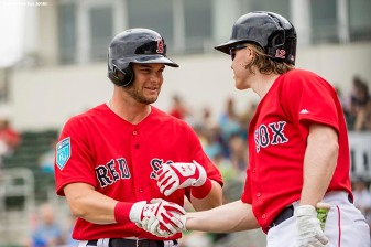 FT. MYERS, FL - FEBRUARY 22: Andrew Benintendi #16 of the Boston Red Sox high fives Brock Holt #12 after scoring during a game against Northeastern University on February 22, 2018 at jetBlue Park at Fenway South in Fort Myers, Florida . (Photo by Billie Weiss/Boston Red Sox/Getty Images) *** Local Caption *** Andrew Benintendi; Brock Holt