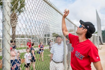 FORT MYERS, FL - FEBRUARY 23: Joe Kelly #56 of the Boston Red Sox tosses a ball to a fan before a game against the Minnesota Twins at JetBlue Park at Fenway South on February 23, 2018 in Fort Myers, Florida. (Photo by Billie Weiss/Boston Red Sox/Getty Images) *** Local Caption *** Joe Kelly