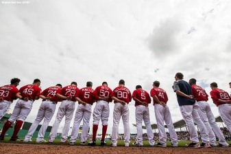 FORT MYERS, FL - FEBRUARY 23: Members of the Boston Red Sox wear the hat of the Marjory Stoneman Douglas High School Eagles baseball team and observe a moment of silence during a game against the Minnesota Twins at JetBlue Park at Fenway South on February 23, 2018 in Fort Myers, Florida. (Photo by Billie Weiss/Boston Red Sox/Getty Images) *** Local Caption ***