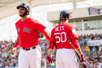 FORT MYERS, FL - FEBRUARY 23: Jeremy Barfield #75 high fives Mookie Betts #50 of the Boston Red Sox after scoring during a game against the Minnesota Twins at JetBlue Park at Fenway South on February 23, 2018 in Fort Myers, Florida. (Photo by Billie Weiss/Boston Red Sox/Getty Images) *** Local Caption *** Jeremy Barfield; Mookie Betts