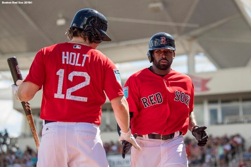 FORT MYERS, FL - FEBRUARY 24: Jackie Bradley Jr. #19 high fives Brock Holt #12 of the Boston Red Sox after scoring during a game against the Tampa Bay Rays at JetBlue Park at Fenway South on February 24, 2018 in Fort Myers, Florida. (Photo by Billie Weiss/Boston Red Sox/Getty Images) *** Local Caption *** Jackie Bradley Jr.; Brock Holt