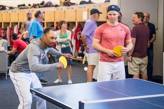 FORT MYERS, FL - FEBRUARY 27: Mookie Betts #50 and Brock Holt #2 of the Boston Red Sox play ping pong before a game against the St. Louis Cardinals at JetBlue Park at Fenway South on February 27, 2018 in Fort Myers, Florida. (Photo by Billie Weiss/Boston Red Sox/Getty Images) *** Local Caption *** Mookie Betts; Brock Holt