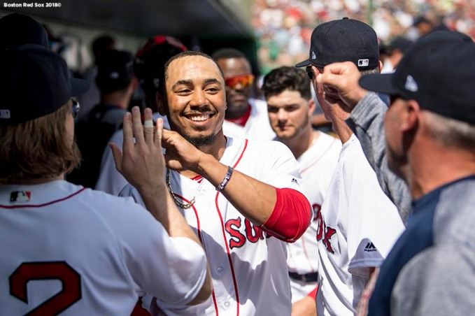FORT MYERS, FL - FEBRUARY 27: Mookie Betts #50 of the Boston Red Sox high fives teammates during a game against the St. Louis Cardinals at JetBlue Park at Fenway South on February 27, 2018 in Fort Myers, Florida. (Photo by Billie Weiss/Boston Red Sox/Getty Images) *** Local Caption *** Mookie Betts