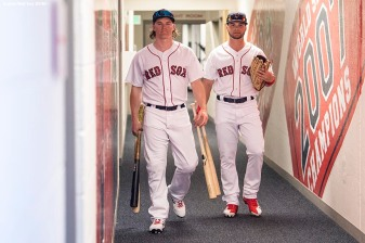 FORT MYERS, FL - FEBRUARY 27: Brock Holt #12 and Andrew Benintendi #16 of the Boston Red Sox walk through the hallway before a game against the St. Louis Cardinals at JetBlue Park at Fenway South on February 27, 2018 in Fort Myers, Florida. (Photo by Billie Weiss/Boston Red Sox/Getty Images) *** Local Caption *** Brock Holt; Andrew Benintendi