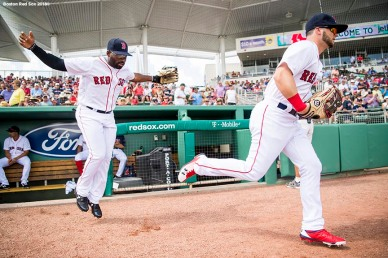 FORT MYERS, FL - FEBRUARY 27: Andrew Benintendi #16 and Jackie Bradley Jr. #19 of the Boston Red Sox run onto the field before a game against the St. Louis Cardinals at JetBlue Park at Fenway South on February 27, 2018 in Fort Myers, Florida. (Photo by Billie Weiss/Boston Red Sox/Getty Images) *** Local Caption *** Andrew Benintendi; Jackie Bradley Jr.