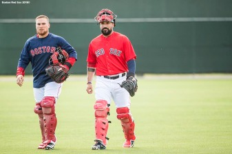 FORT MYERS, FL - FEBRUARY 28: Christian Vazquez #7 and Sandy Leon #3 of the Boston Red Sox walk oward the field before a game against the Pittsburgh Pirates at JetBlue Park at Fenway South on February 28, 2018 in Fort Myers, Florida. (Photo by Billie Weiss/Boston Red Sox/Getty Images) *** Local Caption *** Sandy Leon; Christian Vazquez