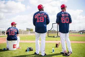 FORT MYERS, FL - FEBRUARY 28: Andrew Benintendi #16, Jackie Bradley Jr. #19, and Mookie Betts #50 of the Boston Red Sox look on before a game against the Pittsburgh Pirates at JetBlue Park at Fenway South on February 28, 2018 in Fort Myers, Florida. (Photo by Billie Weiss/Boston Red Sox/Getty Images) *** Local Caption *** Andrew Benintendi; Mookie Betts; Jackie Bradley Jr.