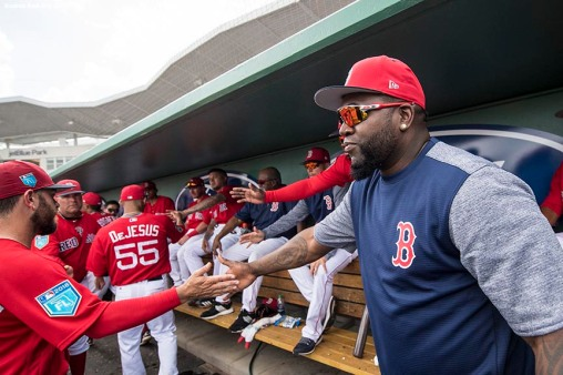 FORT MYERS, FL - FEBRUARY 28: Former designated hitter David Ortiz of the Boston Red Sox high fives teammates in the dugout during a game against the Pittsburgh Pirates at JetBlue Park at Fenway South on February 28, 2018 in Fort Myers, Florida. (Photo by Billie Weiss/Boston Red Sox/Getty Images) *** Local Caption *** David Ortiz