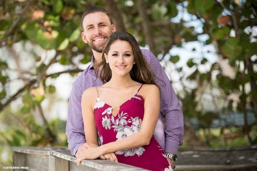 """Matt & Chelsea pose for engagement photos at Seagate Beach in Naples, Florida."""