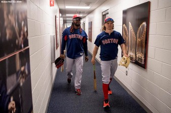 FT. MYERS, FL - MARCH 4: Hanley Ramirez #13 and Brock Holt #12 of the Boston Red Sox walk through the clubhouse during a team workout on March 4, 2018 at Fenway South in Fort Myers, Florida . (Photo by Billie Weiss/Boston Red Sox/Getty Images) *** Local Caption *** Hanley Ramirez; Brock Holt