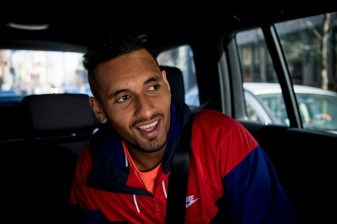 """Australian World Number 20 tennis player Nick Kyrgios reacts in the back seat of a car during a Laver Cup promotional event in Chicago, Illinois Monday, March 19, 2018."""