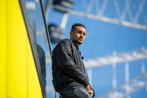 """Australian World Number 20 tennis player Nick Kyrgios poses for a portrait in front of the ferris wheel at Navy Pier during a Laver Cup promotional event in Chicago, Illinois Monday, March 19, 2018."""