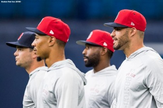 ST. PETERSBURG, FL - MARCH 28: Andrew Benintendi #16, Mookie Betts #50, Jackie Bradley Jr. #19, and J.D. Martinez #28 of the Boston Red Sox look on during a team workout before Opening Day on March 28, 2018 at Tropicana Field in St. Petersburg, Florida . (Photo by Billie Weiss/Boston Red Sox/Getty Images) *** Local Caption *** Mookie Betts; Andrew Benintendi; Mookie Betts; Jackie Bradley Jr.