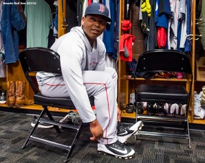 ST. PETERSBURG, FL - MARCH 29: Rafael Devers #11 of the Boston Red Sox puts on his cleats before the Opening Day game against the Tampa Bay Rays on March 29, 2018 at Tropicana Field in St. Petersburg, Florida . (Photo by Billie Weiss/Boston Red Sox/Getty Images) *** Local Caption *** Rafael Devers