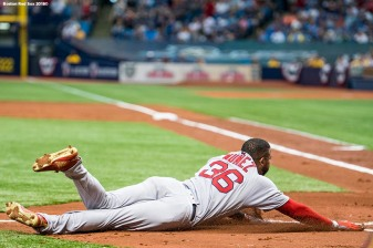 ST. PETERSBURG, FL - MARCH 29: Eduardo Nunez #6 of the Boston Red Sox slides into home plate as he hits an inside the park home run during the second inning of the Opening Day game against the Tampa Bay Rays on March 29, 2018 at Tropicana Field in St. Petersburg, Florida . (Photo by Billie Weiss/Boston Red Sox/Getty Images) *** Local Caption *** Eduardo Nunez