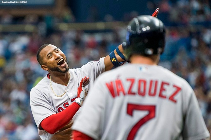 ST. PETERSBURG, FL - MARCH 29: Eduardo Nunez #6 of the Boston Red Sox reacts with Christian Vazquez #7 after hitting an inside the park home run during the second inning of the Opening Day game against the Tampa Bay Rays on March 29, 2018 at Tropicana Field in St. Petersburg, Florida . (Photo by Billie Weiss/Boston Red Sox/Getty Images) *** Local Caption *** Eduardo Nunez; Christian Vazquez