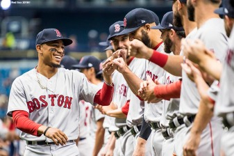 ST. PETERSBURG, FL - MARCH 29: Mookie Betts #50 of the Boston Red Sox high fives teammates as he is introduced before the Opening Day game against the Tampa Bay Rays on March 29, 2018 at Tropicana Field in St. Petersburg, Florida . (Photo by Billie Weiss/Boston Red Sox/Getty Images) *** Local Caption *** Mookie Betts