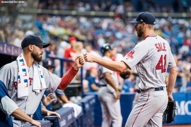 ST. PETERSBURG, FL - MARCH 29: Chris Sale #41 of the Boston Red Sox high fives Rick Porcello #22 after exiting the game during the seventh inning of the Opening Day game against the Tampa Bay Rays on March 29, 2018 at Tropicana Field in St. Petersburg, Florida . (Photo by Billie Weiss/Boston Red Sox/Getty Images) *** Local Caption *** Rick Porcello; Chris Sale
