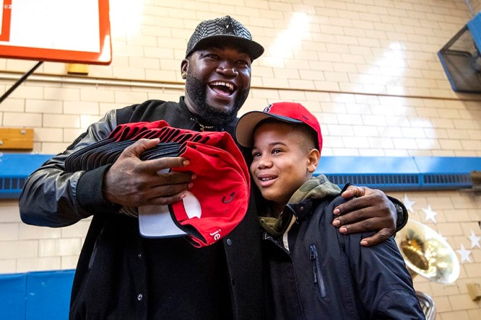 BOSTON, MA - APRIL 4: Former Boston Red Sox designated hitter David Ortiz presents a student with a hat during a hat donation event at the Hurley School on April 4, 2018 in Boston, Massachusetts. (Photo by Billie Weiss/Boston Red Sox/Getty Images) *** Local Caption *** David Ortiz