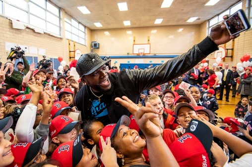 BOSTON, MA - APRIL 4: Former Boston Red Sox designated hitter David Ortiz poses for a selfie photograph as he distributes hats to students hat donation event at the Hurley School on April 4, 2018 in Boston, Massachusetts. (Photo by Billie Weiss/Boston Red Sox/Getty Images) *** Local Caption *** David Ortiz