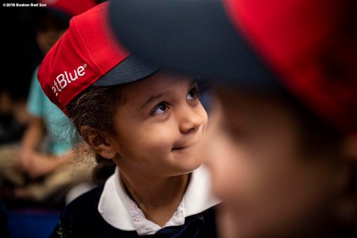 BOSTON, MA - APRIL 4: A student receives a Boston Red Sox hat during a hat donation event at the Hurley School on April 4, 2018 in Boston, Massachusetts. (Photo by Billie Weiss/Boston Red Sox/Getty Images) *** Local Caption ***